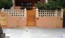 puerta jardin machambrado simil madera vista frontal