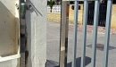 puerta acero inox barrotes aluminio motorizada