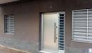 puerta aluminio anodizado panel liso